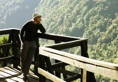Tourist in jungle Stock Image