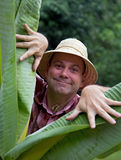 Tourist in the jungle Stock Photography