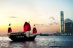 Tourist junk crossing Victoria Harbour, Hong Kong Royalty Free Stock Photo