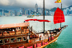 Tourist junk. Hong Kong -  May 18, 2013: Traditional chinese-style tourist junk sailing in Hong Kong harbor . Overall visitor arrivals to Hong Kong in 2012 Royalty Free Stock Image