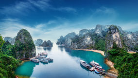 Tourist junks at Ha Long Bay, Vietnam. Tourist junks floating among limestone rocks at Ha Long Bay, South China Sea, Vietnam, Southeast Asia