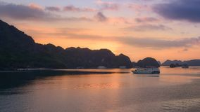 Tourist Junks in Halong Bay,Panoramic view of sunset in Halong Bay, Vietnam, Southeast Asia royalty free stock images