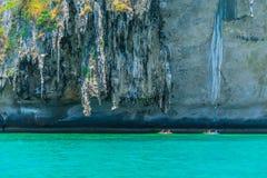 Tourist Kayak boat trip at Krabi Andaman sea cliff Thailand. Summer travel Royalty Free Stock Photo