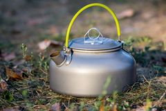 Tourist kettle in grass Royalty Free Stock Photos