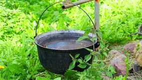 Tourist kettle at outdoor with grass around stock video footage