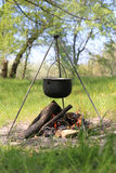 Tourist kettle over fire in forest Stock Image