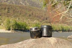 Tourist kettles Stock Image