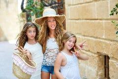 Tourist kid girls group in mediterranean white town Stock Photography