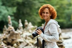 Tourist lady with camera stock photo