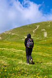 Tourist lady hiking on Iezer peak in Romania Royalty Free Stock Photo