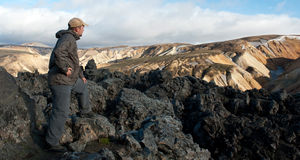 Tourist at Landmannalaugar lava field Royalty Free Stock Photos