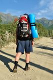 Tourist with a large backpack is a high mountain, Royalty Free Stock Photos