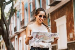 Tourist latin girl with map, travel, leisure, holidays in a Hispanic and colonial city in Mexico. Mexican girl royalty free stock images