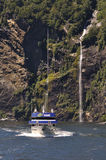 Tourist Launch At Milford Sound, New Zealand Royalty Free Stock Photo