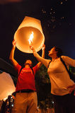 Tourist launching sky lantern Royalty Free Stock Photo