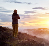 Tourist on lava fields Royalty Free Stock Images