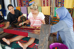 Tourist learns traditional weaver Royalty Free Stock Image