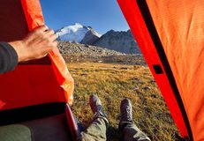 Tourist legs in the tent outdoors Royalty Free Stock Image