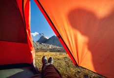 Tourist legs in the tent outdoors Stock Images