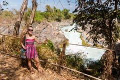 Tourist on Li Phi waterfall Royalty Free Stock Photo