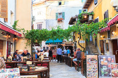 Tourist life in Porec. POREC, CROATIA - JULY, 14: View of restaurants, pubs and bars in the center town on July 14, 2017 Royalty Free Stock Photo