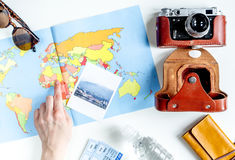 Tourist lifestyle with camera and map white table background top view Stock Image