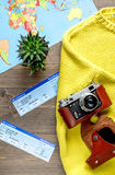 Tourist lifestyle with tickets and camera wooden table background top view. Tourist lifestyle with photo camera and flight tickets on wooden table background top Stock Images