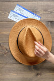 Tourist lifestyle with tickets and hat wooden table background top view Royalty Free Stock Image