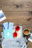 Tourist lifestyle with tickets and passport wooden table background top view mockup. Tourist lifestyle with bag, flight tickets and passport on wooden table Stock Photos