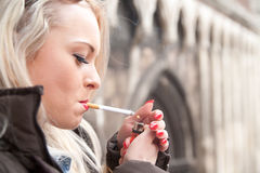 Tourist lighting up a a cigarette in an European city Stock Image