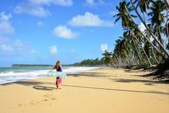 Tourist on the Limon beach on Dominican Republic. Relaxing tourist on the empty, long Limon beach on Dominican Republic Royalty Free Stock Image