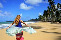 Tourist on the Limon beach on Dominican Republic. Relaxing tourist on the empty, long Limon beach on Dominican Republic Royalty Free Stock Photo