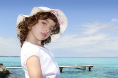 Tourist little girl hat formentera turquoise sea Stock Photography