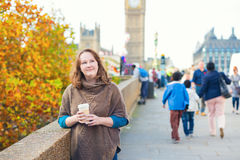 Tourist in London walking on with coffee Royalty Free Stock Photos