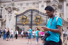 Tourist in london. Young indian man visiting London reading his map Stock Photos