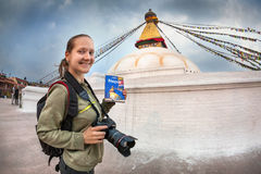 Tourist with Lonely Planet guide in Nepal Royalty Free Stock Photography