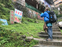 Tourist look for guest house in Tiantouzhai Royalty Free Stock Photography