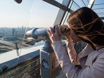 Tourist look observant binoculars telescope on panoramic view Royalty Free Stock Images