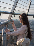 Tourist look observant binoculars telescope on panoramic view. Lifestyle concept trip, traveler with backpack on background city Royalty Free Stock Image