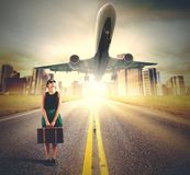 Tourist look plane. A tourist looks at a plane taking off Royalty Free Stock Images