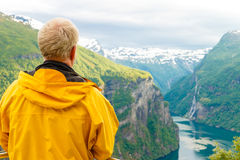 Tourist Looking At Geirangerfjord From Flydasjuvet Viewpoint Norway Royalty Free Stock Photography