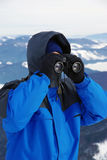 Tourist looking through binocular. Tourist on mountain looking through binocular royalty free stock photography