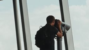 Tourist looking through binoculars on observation deck in tower Ho Chi Minh city. Observation deck tower in Ho Chi Minh city with tourists stock footage