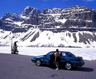 Tourist looking at Bow Lake, Canada. Royalty Free Stock Photography