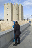 Tourist looking Calahorra tower by urban telescope Royalty Free Stock Image