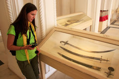 Tourist looking at display of swords, Mehrangarh Fort museum, Jo Royalty Free Stock Images