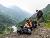 Tourist looking down to the valley. Marsyangdi river valley - Annapurna Circuit trek - Nepal stock photography