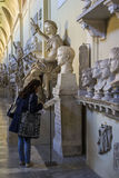 Tourist looking at exhibition at Vatican Museum in Italy Stock Image