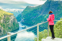 Tourist looking at Geirangerfjord from Flydasjuvet viewpoint Norway Royalty Free Stock Image