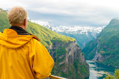 Tourist looking at Geirangerfjord from Flydasjuvet viewpoint Norway Royalty Free Stock Photo